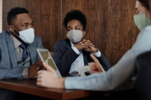 lawyer having a conversation with masks on