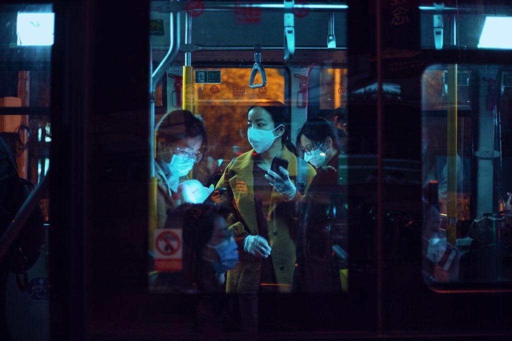 women wearing masks on a train
