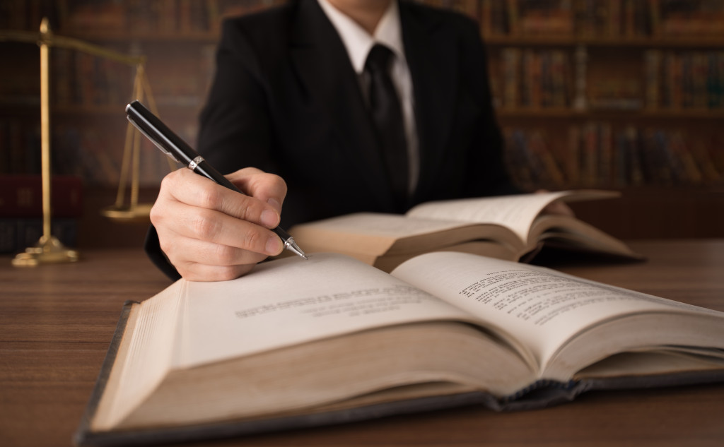 a person writing on a book